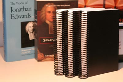 Rebound Bibles show off their spiral binding and black covers.